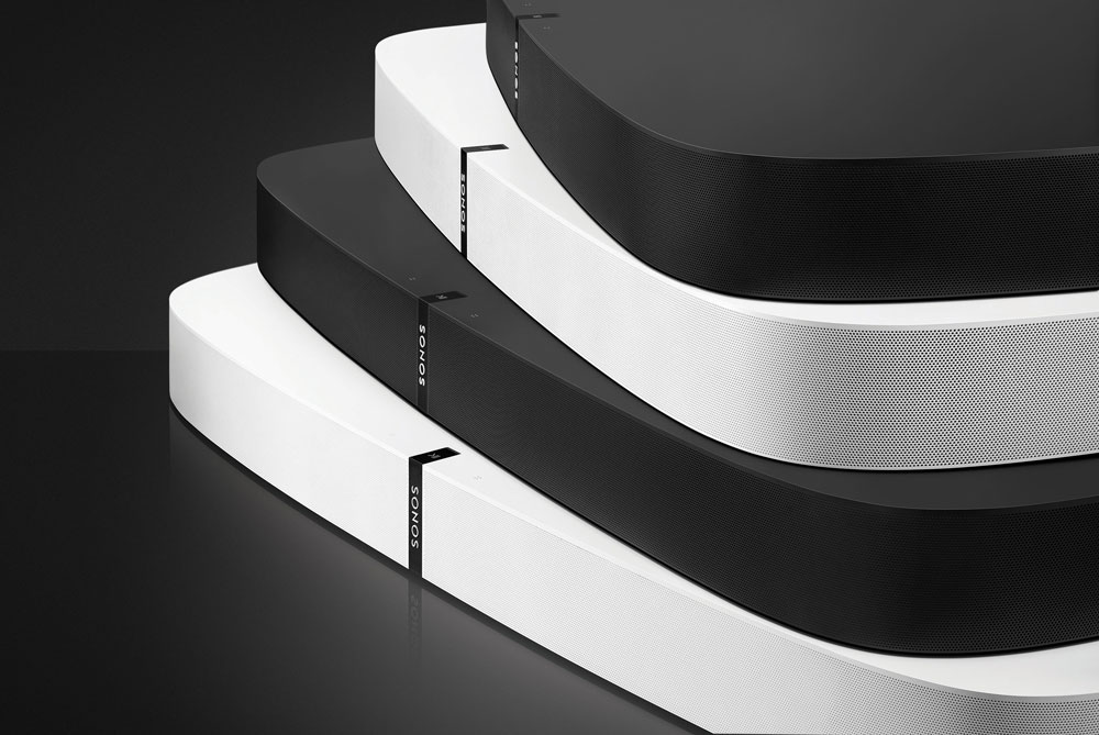 Four Sonos Playbases stacked on top of each other