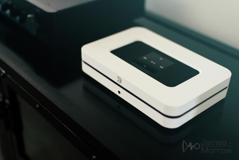 Bluesound Node 2i white on stand close-up lifestyle image