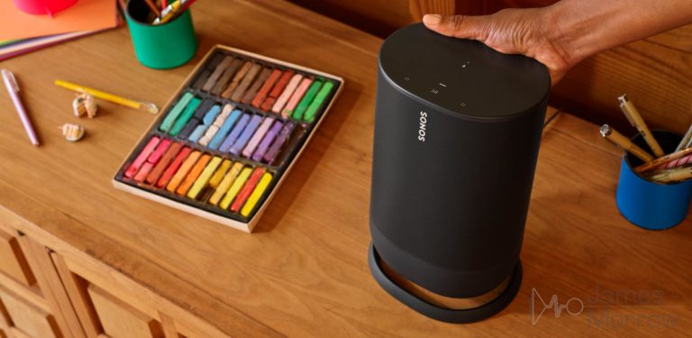 Sonos Move being picked up from table near crayons