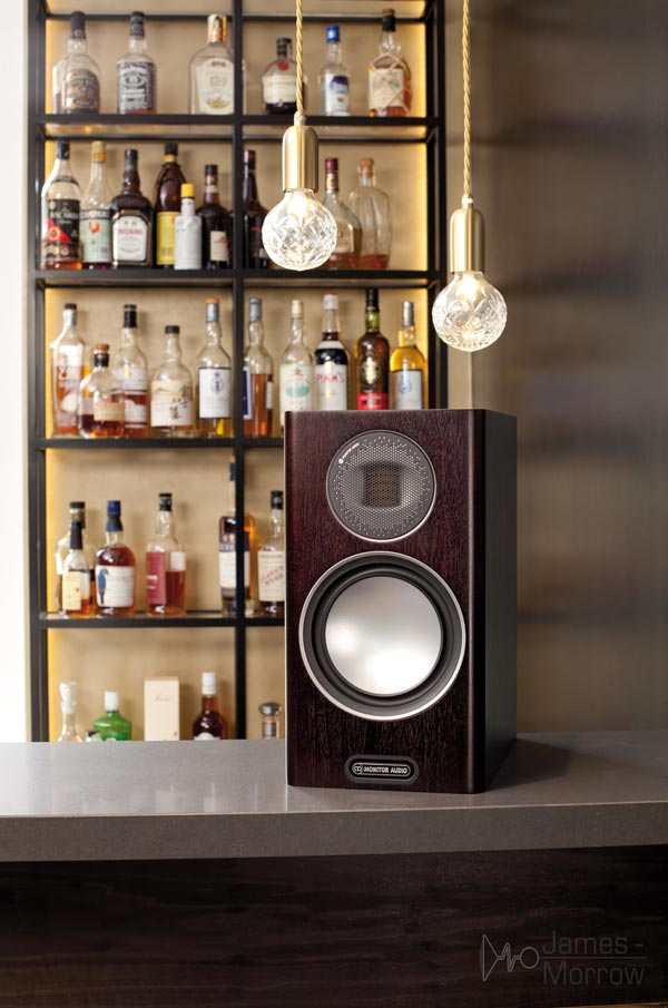 Monitor Audio Gold 100 walnut close-up in front of bar lifestyle image