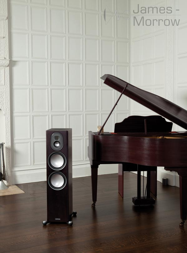 Monitor audio gold 300 walnut near piano lifestyle image