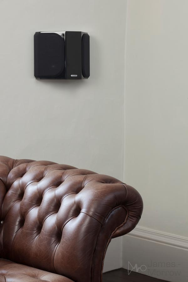 monitor audio gold fx black wall mounted above couch black lifestyle image