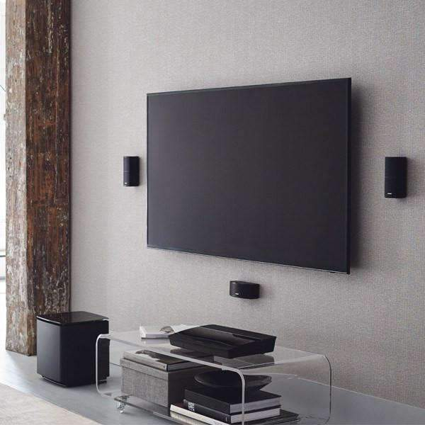 Bose Lifestyle 600 black installed near TV on bright wall