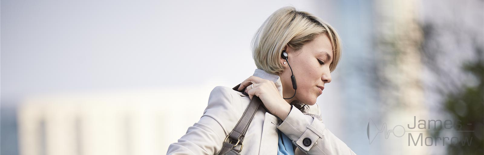 Bose QC30 being worn by woman lifestyle banner image
