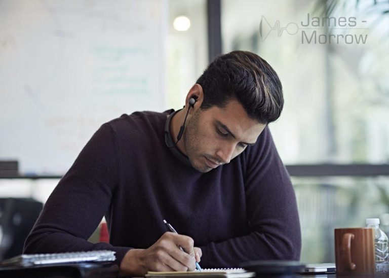 Bose QC30 being worn by man lifestyle image
