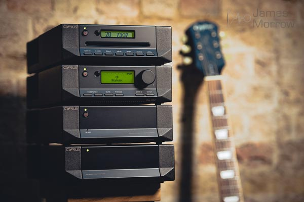 Cyrus X Power hifi stack with guitar in background lifestyle image