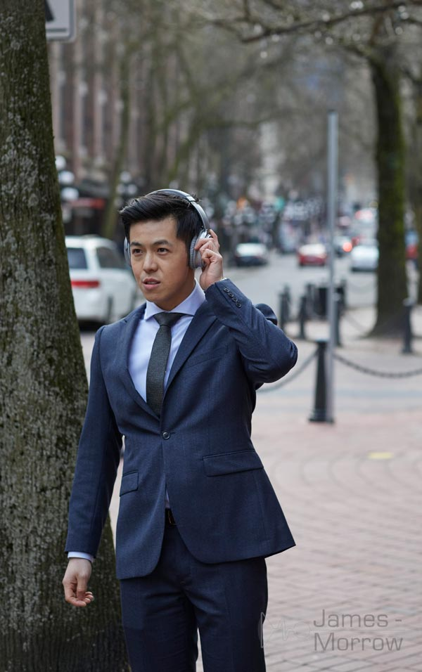 Bose QuietComfort 35 II Silver being worn by businessman lifestyle image