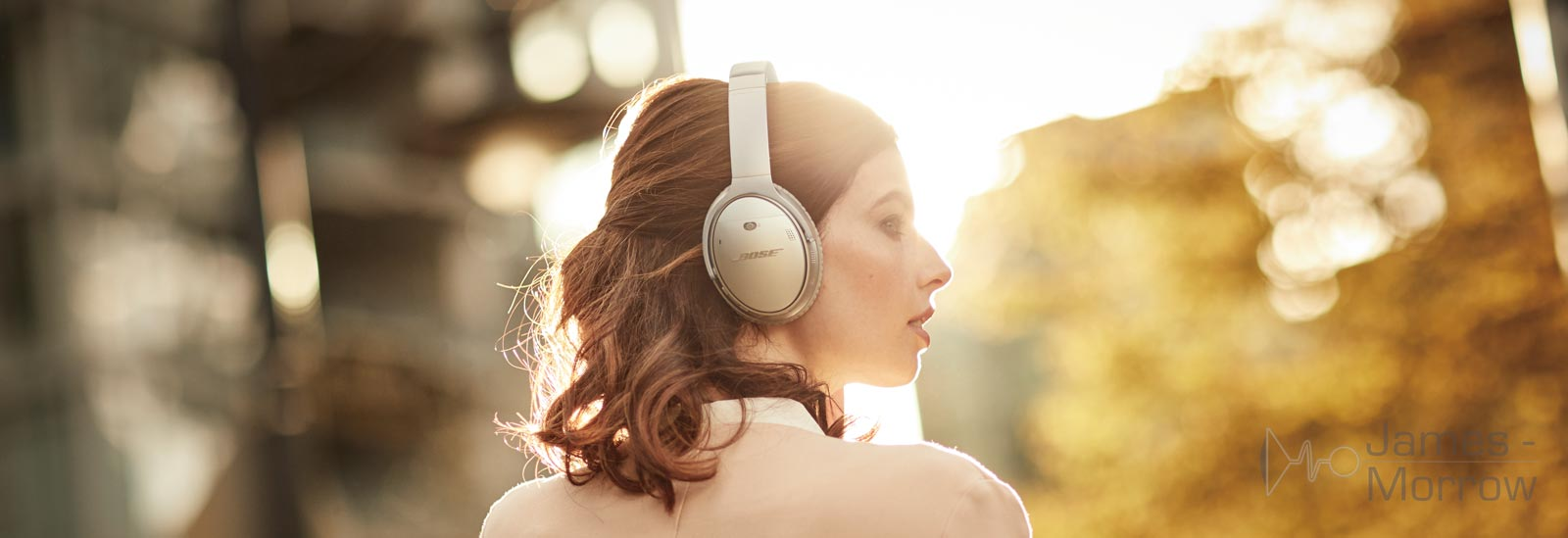 Bose QuietComfort 35 II Silver being worn by woman side profile lifestyle banner image