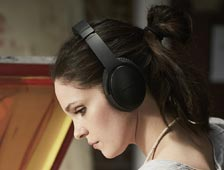 Woman wearing Bose headphones