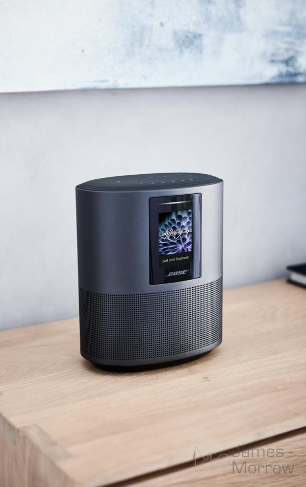 bose home speaker 500 black on wooden table lifestyle image