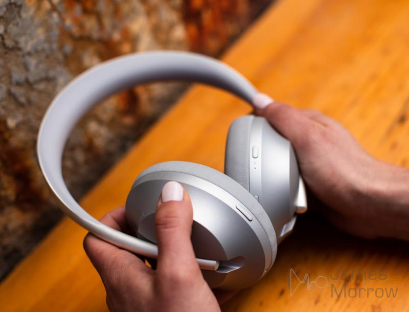 Bose Headphone 700 silver being held close-up lifestyle image
