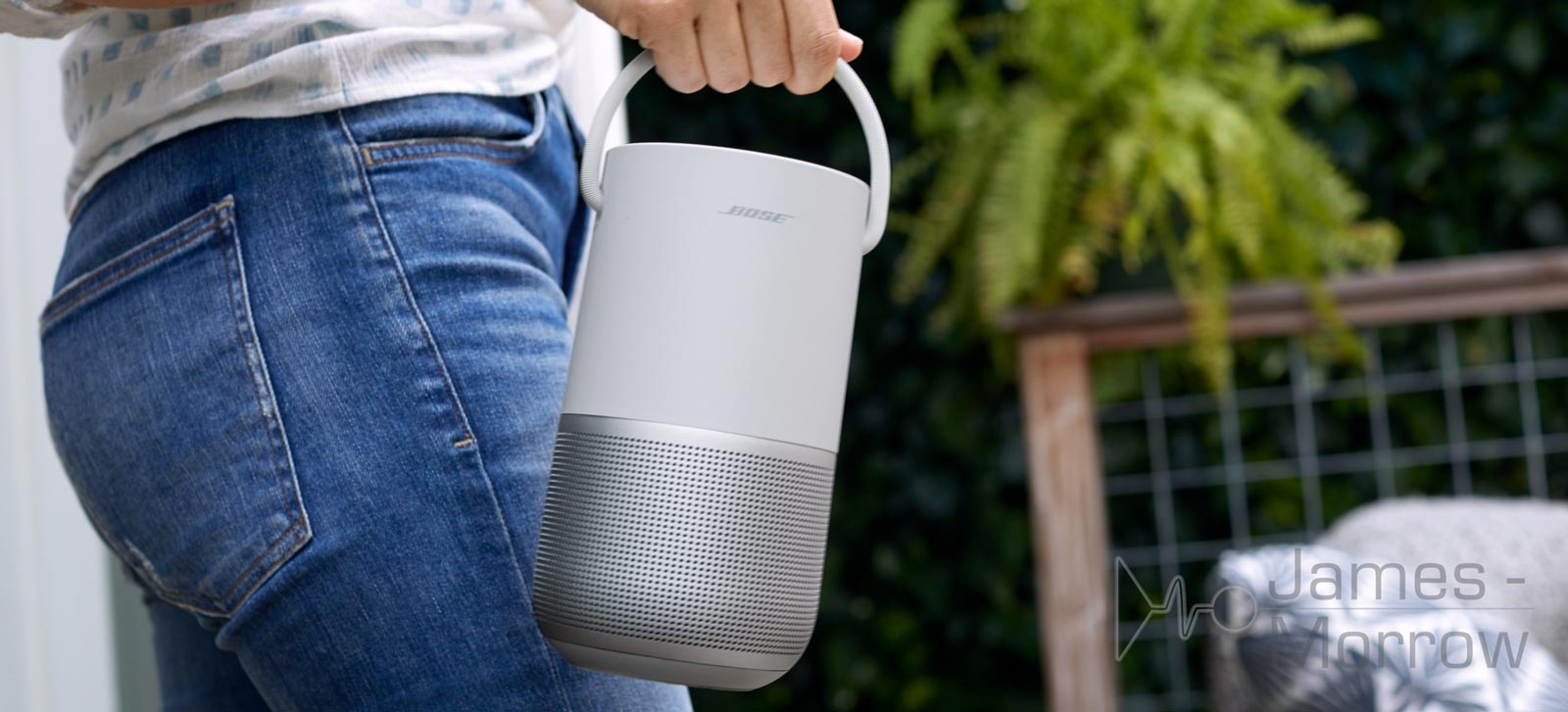 bose portable home speaker silver being carried lifestyle image