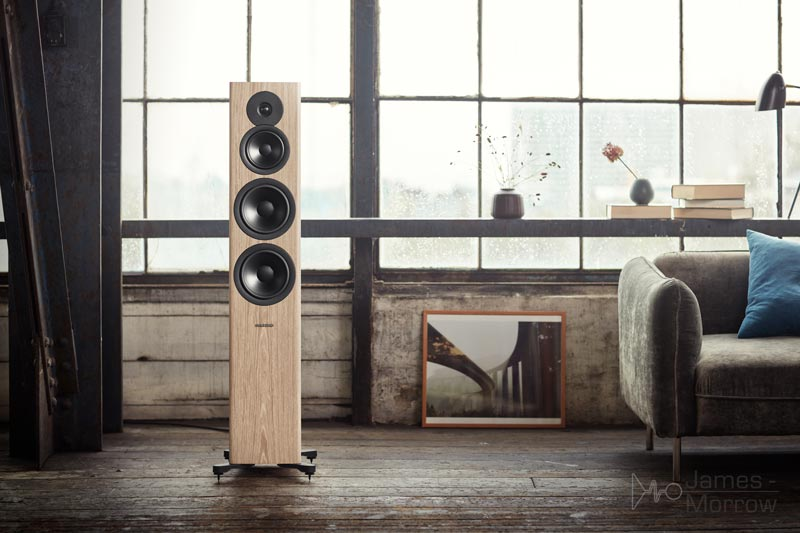 Dynaudio Evoke 50 speakers in blonde wood in contemporary living space front lifestyle image