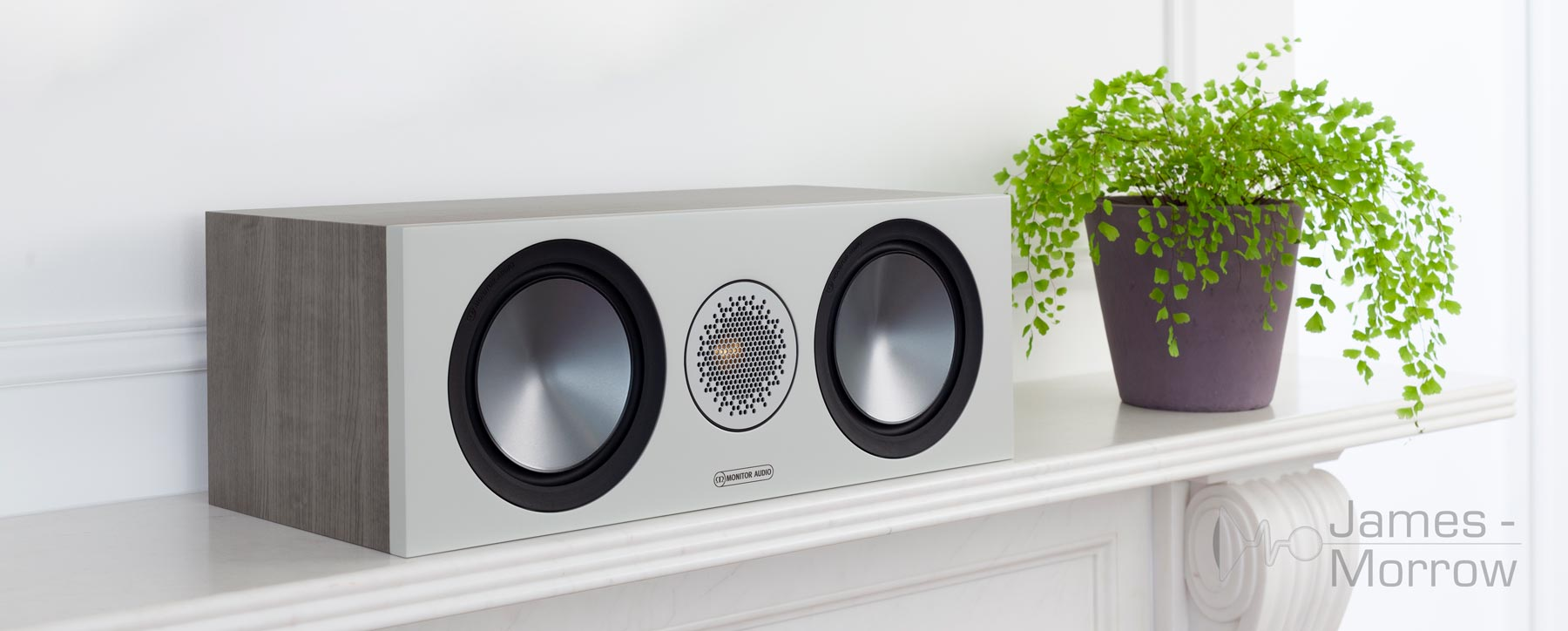 Monitor Audio Bronze C150 Urban Grey on white mantlepiece lifestyle image