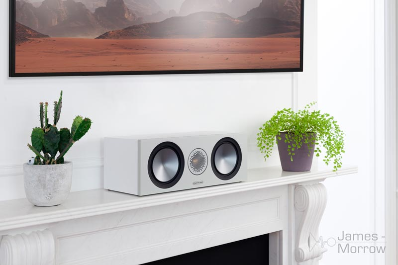 Monitor Audio Bronze C150 White on white mantlepiece lifestyle image