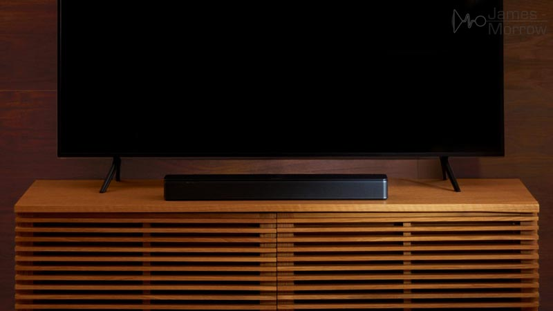 Bose TV Speaker on TV stand lifestyle image