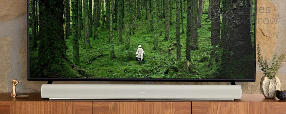 Sonos Arc white underneath TV on stand lifestyle image banner image