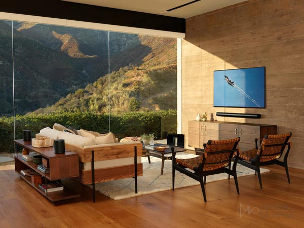 sonos arc wall mounted underneath TV in modern living room lifestyle image