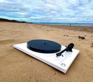 rega planar 1 white on beach news feature image